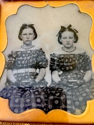 Ambrotypes. Sisters early 1850's. Note the fabulous matching dresses and tinted cheeks. Love these girls.