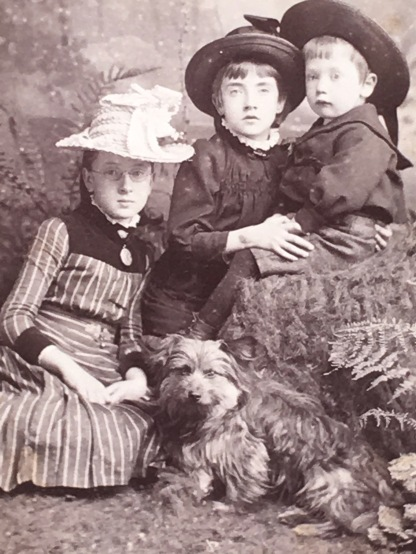 Any good mother would know to start their children off early with stylish hats. Of course they had a dog.