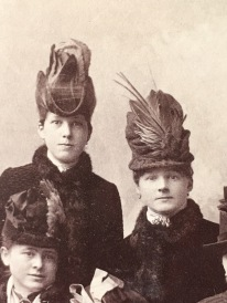 Notice the feathers. Now imagine the wild bright colors these hats were. There was nothing drab about the colors these women were wearing. We only see them in black and white. Imagine the colors!