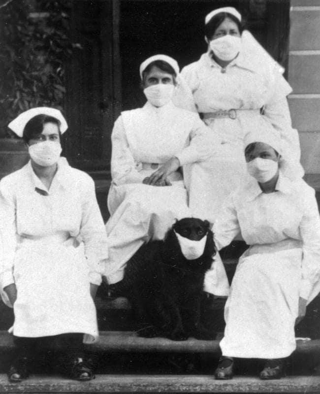1918 nurses with dog and masks
